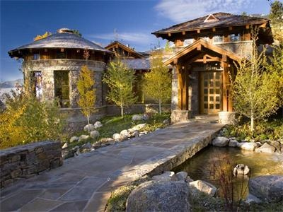 Love the beautiful stonework in this front entrance landscape.