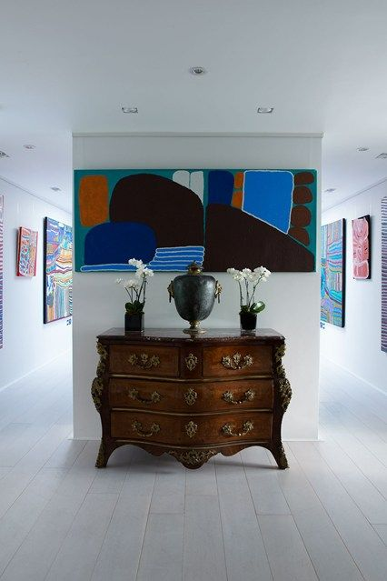 Discover ideas for displaying art on HOUSE - design, food and travel by House & Garden. Modern art sits well with antique furniture, as in the hallway of this South London penthouse.