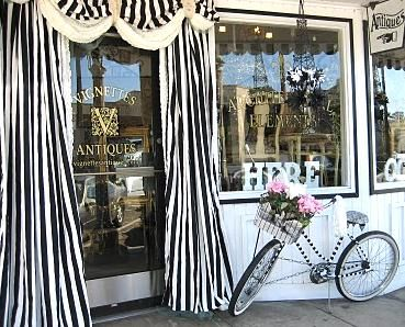wonderful...the dramatic drapes...the vintage bike....would so love to own an antique store!