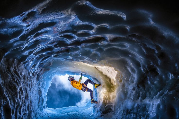 The Cave: Deep, blue and cold. The frightening experience of climbing inside an ice cave on the north face of alpine summit at 3,800 m above sea level is very difficult to describe in words. Especially in summer, when all the glacial ice melts making the place for completely new formations.  (© Kamil Tamiola/National Geographic Traveler Photo Contest)