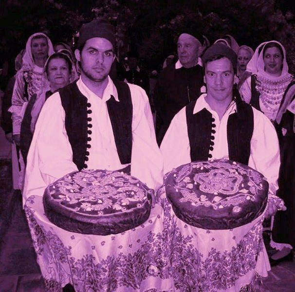 TRADITIONAL COSTUMES-AVLONAS ATTICA. the groom's and the bride's wedding breads. all rights reserved