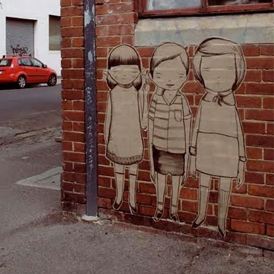 People who pepper the city with their art - Three kids on a brick wall, Melbourne, by Ghost Patrol.