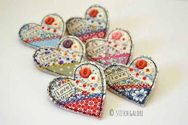 Handmade textile heart shaped brooches by Stitch Galore. Embellished with lace, wording, embroidery and buttons. www.stitchgalore.com