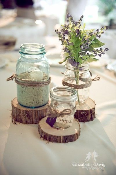 rustic wedding, we could easily do this with either mason jars with sand and candles (and twine) or with the winebottles wrapped in twine.