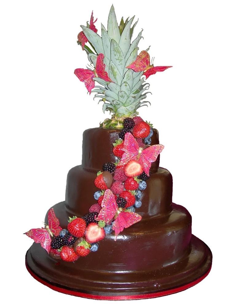 Tropical Belgian chocolate wedding cake with fresh seasonal fruits.