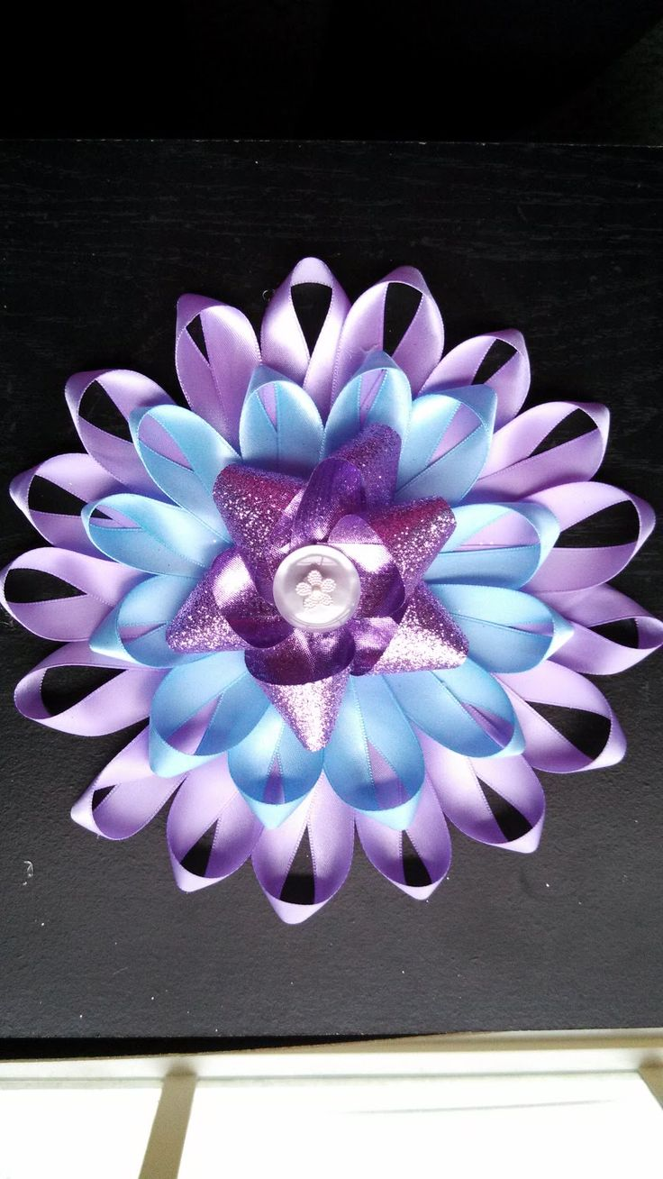 Anne has lots of ribbon flowers on her ribbon crafts board.......Alli Crafts: Craft Tutorial: Large Ribbon Flower For Leah :)