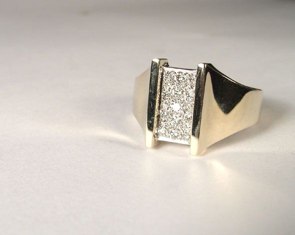 This ring was a remodel of a collection of worn out jewellery. Pave is a great way to utilise different sized diamonds