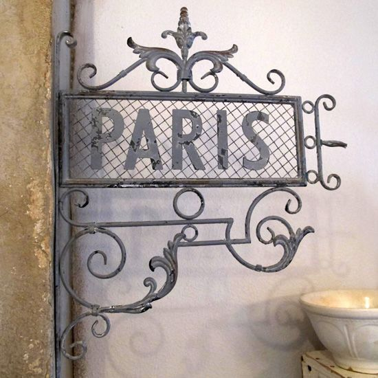 Paris Street Sign -- I have this in my kitchen.  When I look at it, it brings back fond memories of my trips there.