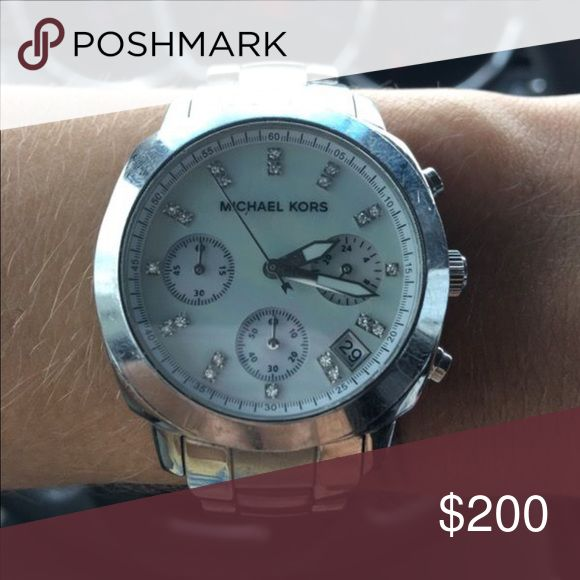 Michael Kors Watch (price negotiable) Pearl faced with diamond accents. Gently used! I've recently purchased a new watch and found myself falling out of live with this one. I receive so many compliments on this watch- great buy! Price is negotiable. Michael Kors Accessories Watches