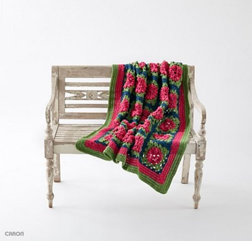 A bright and cheerful blanket, the Petal Pops blanket is easily crocheted in Caron One Pound yarn.