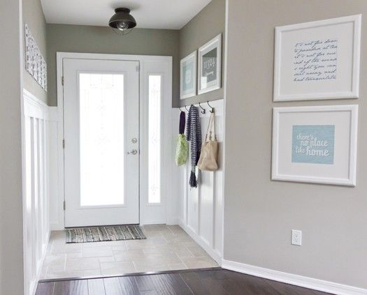 I love how the use of colors/details opens up what would be an otherwise poky hallway.  Good article on entryway use.