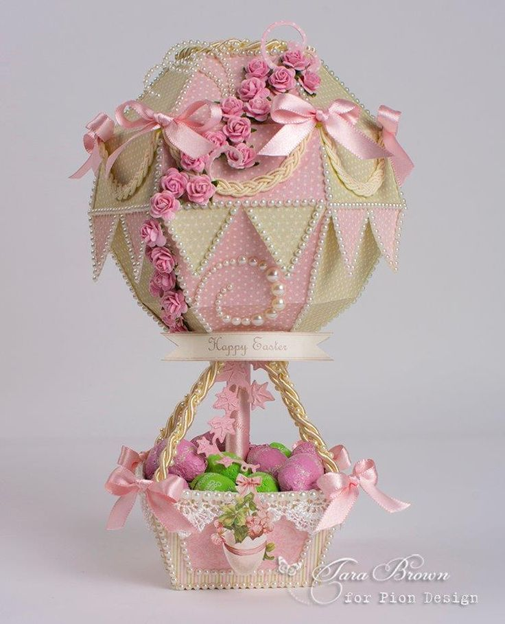This Hot Air Balloon 3D project makes a great little Easter Basket. It's filled with wrapped chocolate eggs and was made using a cutting file from Pazzles found here. The pink and green pas…
