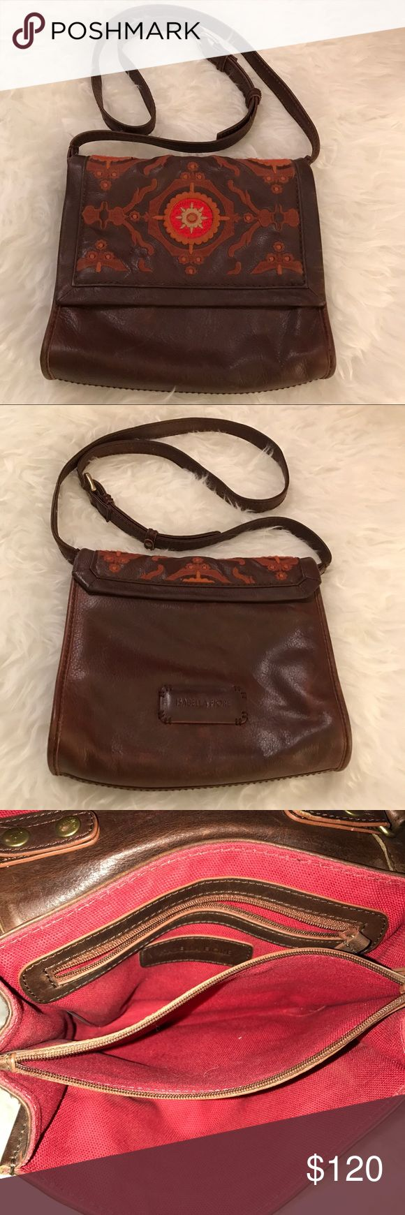 Isabella Fiore Brown Crossbody Coachella Bag Cute brown Leather Isabella Fiore Crossbody. This is a magnetic closure Purse. Long straps. Super cute and good preloved condition. Has some minor scratches (refer to the photo up top) but unnoticeable unless the flash is on. It looks super 70's and very Coachella feel! Interior is great condition and has a zipper pocket and has 4 pockets (2 zipper and two open) Fits wallet, phone and little makeup! Just trying to save for our wedding next year…