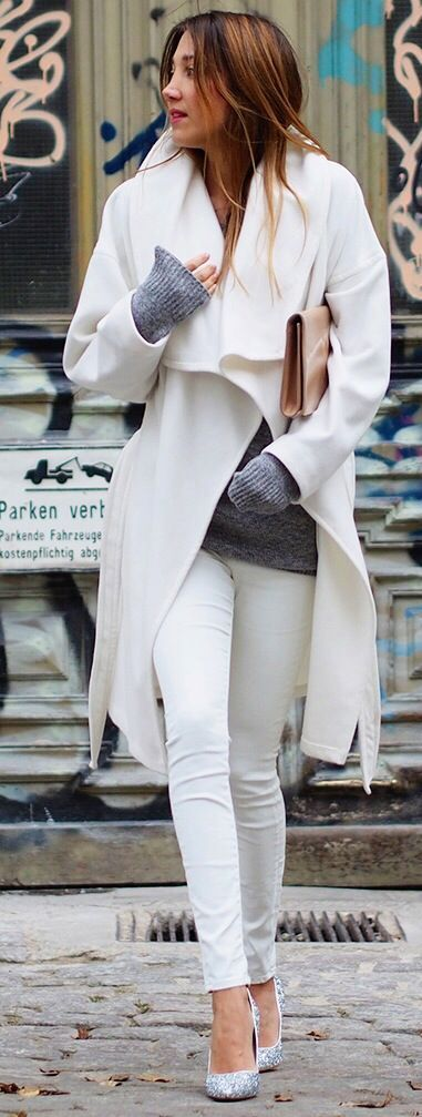 Winter white coat, white leather pants, light grey knit sweater plus glittery pumps and my nude clutch