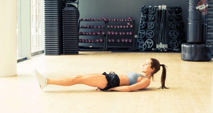 Kayla Itsine's Crazy-Good Ab and Arm Workout: how to do bent leg raises | coveteur.com