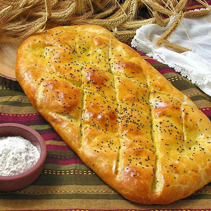 Tandir bread is an Azeri bread that is traditionally baked in a clay oven after being brushed with egg or yogurt.