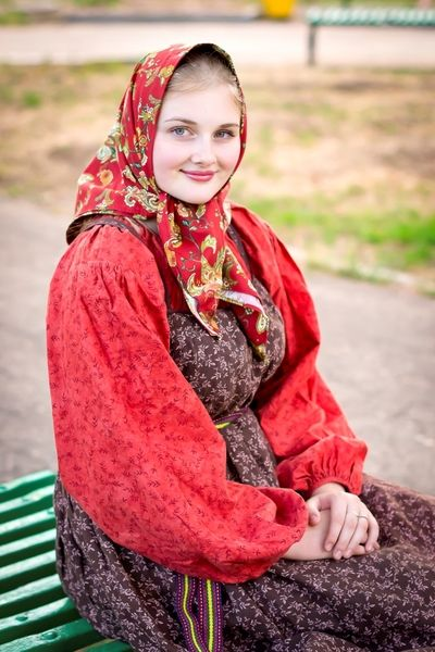 Traditional casual costume of a peasant girl from Northern provinces, Russia. Modern work according to the fashion of the 19th century.