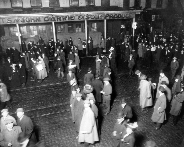 People gather in New York to await the arrival of survivors of the sinking of the RMS Titanic aboard the RMS Carpathia on April 18, 1912. (The New York Times)