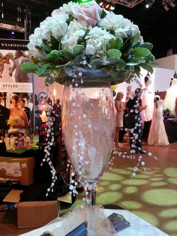 Champagne glass floral arrangement centerpieces