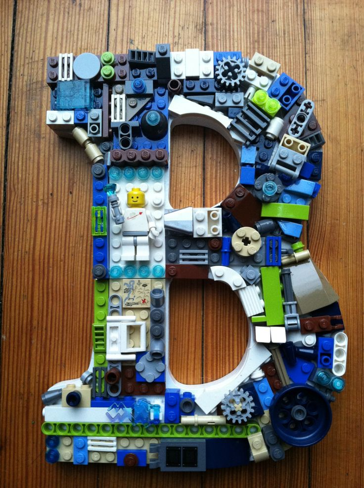 Custom Lego letter B,  made to order. $45.00, via Etsy.    I love this, but the idea of gluing Lego pieces to something makes me cringe.   :)