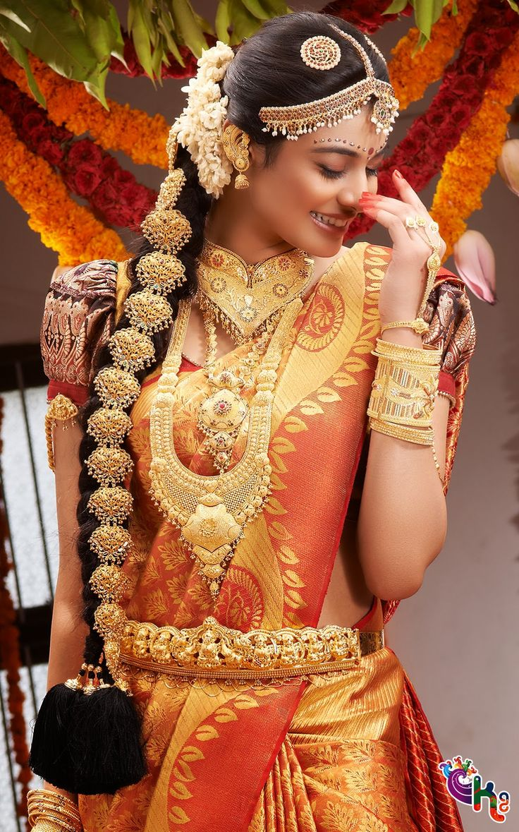 South Indian bride. Temple jewelry. Jhumkis.Red silk kanchipuram sari.Braid with fresh jasmine flowers. Tamil bride. Telugu bride. Kannada bride. Hindu bride. Malayalee bride.Kerala bride.South Indian wedding