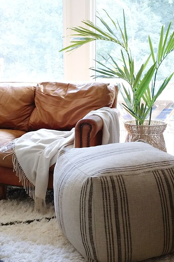 have a seat u2013 jonathan louis poufs save the day tan leather couchessave