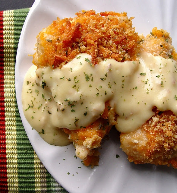 4 large chicken breasts 2 sleeves Ritz crackers 1/4 t salt 1/8 t pepper 1/2 C milk 3 C cheddar cheese, grated 1 t dried parsley Sauce: 1 10 ounce can cream of chicken soup 2 T sour cream 2 T butter dip chicken in milk, roll in cheese, coat with crakcer crumbs. Spray pan, lay in chicken, sprinkle w/parsley. Bake 350 35 min w/foil cover. Remover cover bake 10 more minutes.