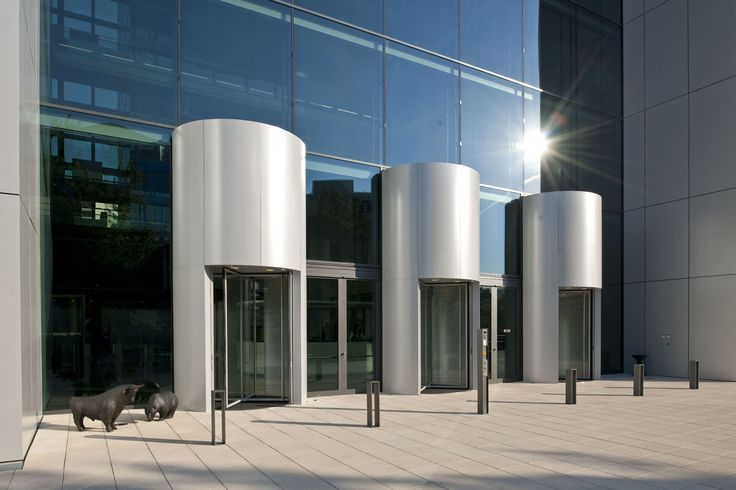 High Revolving Doors. Deutsche Börse Cube  The Cube is a commercial development for the German Stock Exchange Group located in the city of Eschborn, Germany.