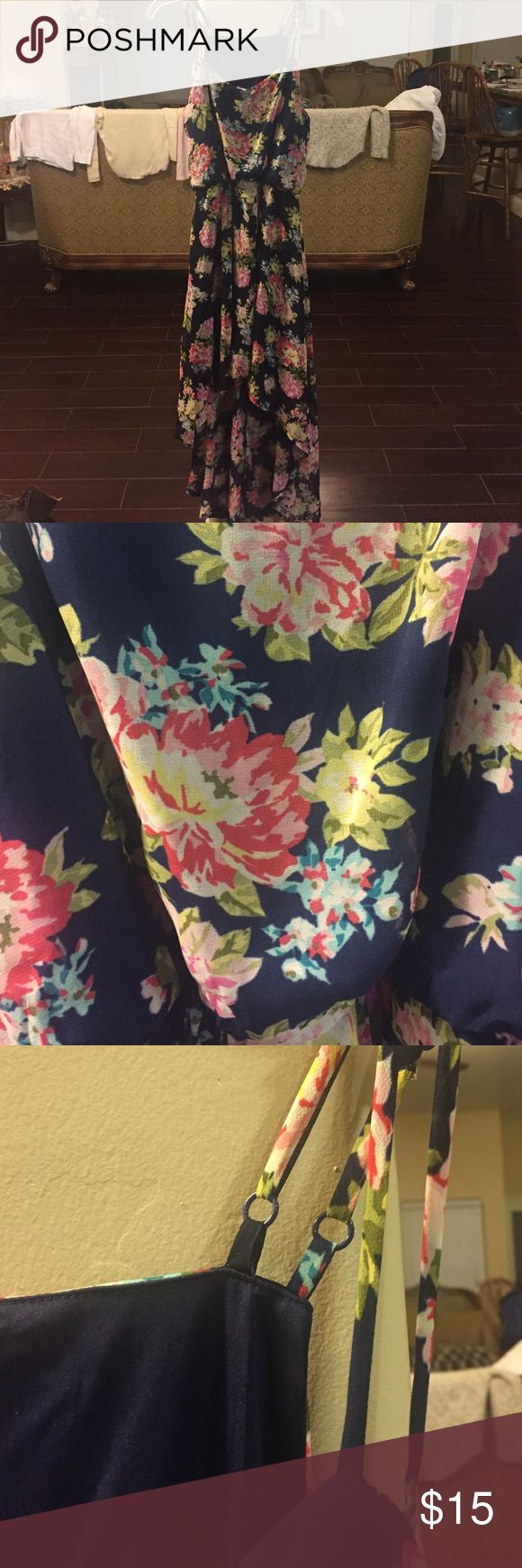 Flower print women's high low dress Flower print women's dress. High low style. Very flowy and great for summer and spring. Does not have a size tag but I am a medium and it fits. Offers welcomed. Dresses High Low
