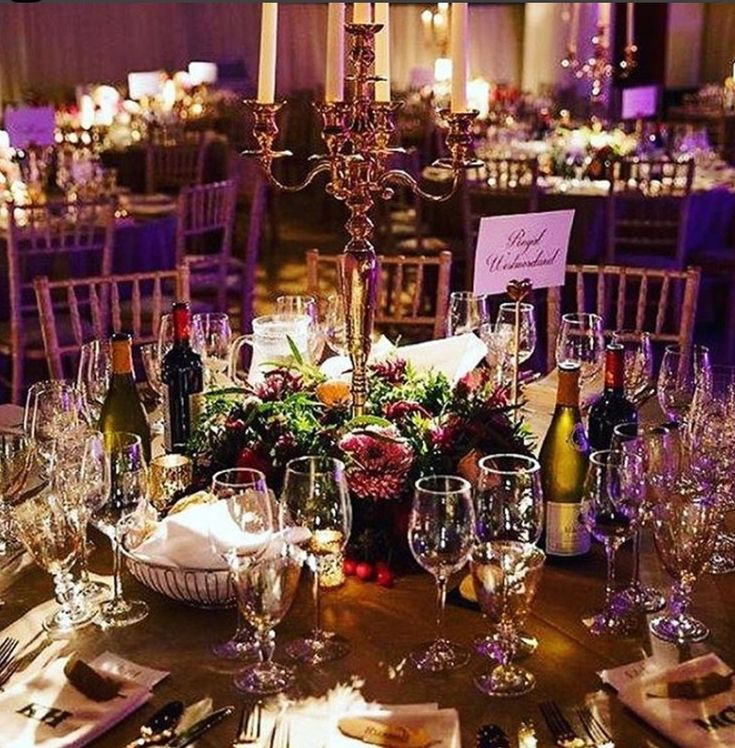 Brass candelabra by Stressfreehire dressed by Nordic Twigs at a marquee event in Sussex  #venuetransformers