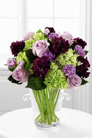 Purples and Greens. Classic, Clean, Fresh. #hyrdangeas #purple #roses #champagne