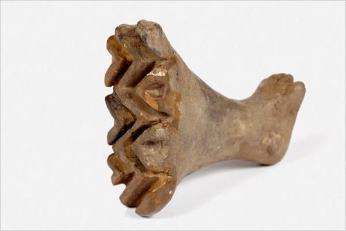 Fired clay pintadera in the shape of a left leg, 6200-5500 BC.  Cucuteni-Trypillian culture.