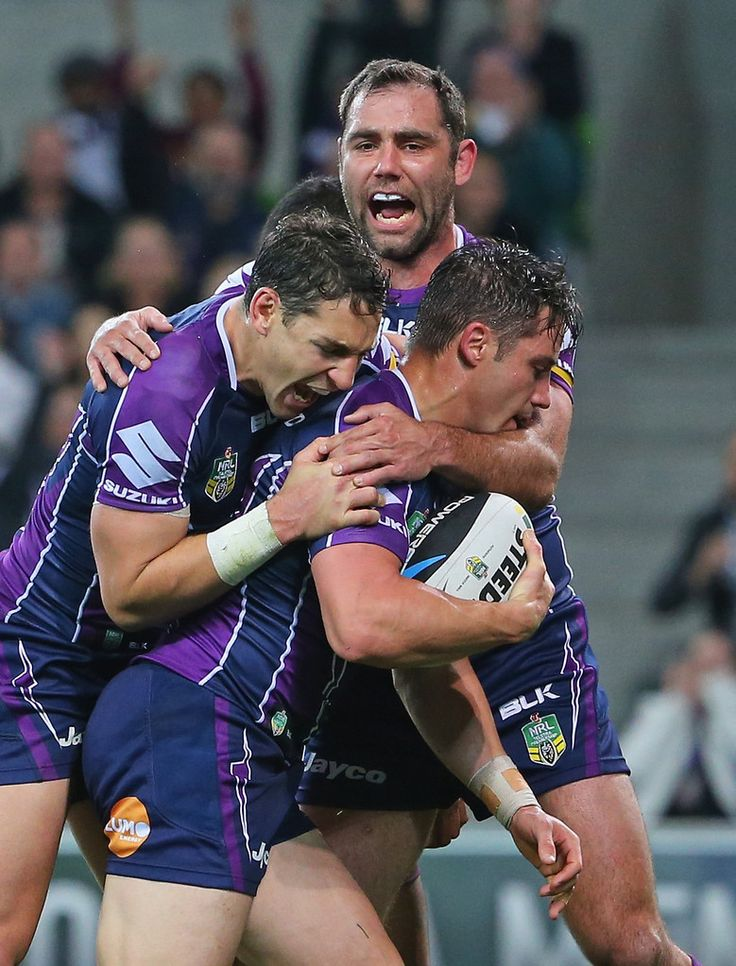 Cooper and Billy Slater behind
