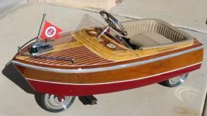 Antique boat pedal car