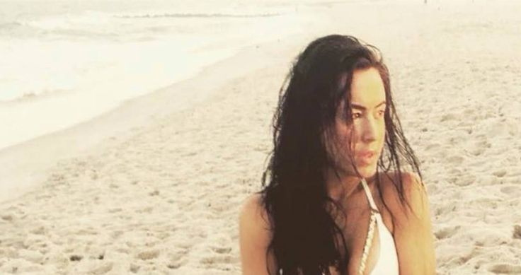I'm not going to say her name, but her initials are Andrea Tantaros - and she's galavanting around in the sand wearing next to nothing