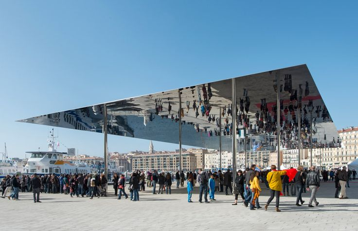 The brand new 'Port Vieux' pavilion in Marseille, France is a 46x22 meter canopy made from polished stainless steel that reflects the pedestrian area of the harbor and surrounding wharf. Designed by Foster + Partners, the pavilion is part of a move to reclaim civic spaces over the water. With landscape design by Michel Desvigne, the granite surface is able to mimic the original limestone and blend in with the existing port.