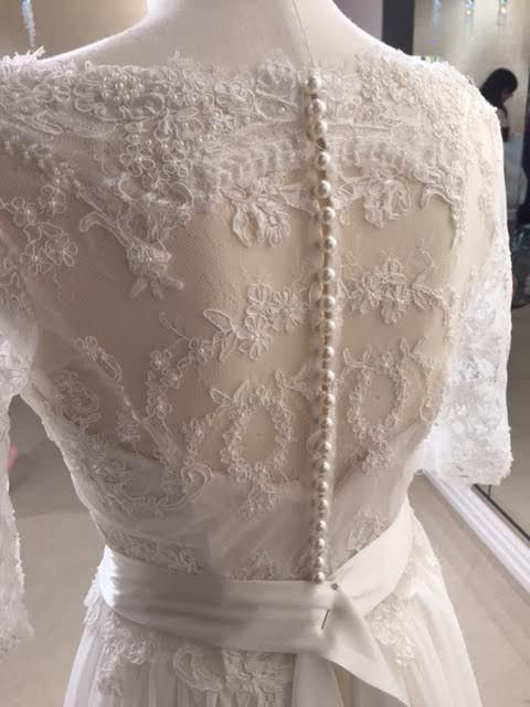 hand beaded corded lace with pearl buttons, the back of this clients gown was a statement  #lace #weddingdressdetail #weddingdressdesigner #weddingdressnz #nz #weddingnz