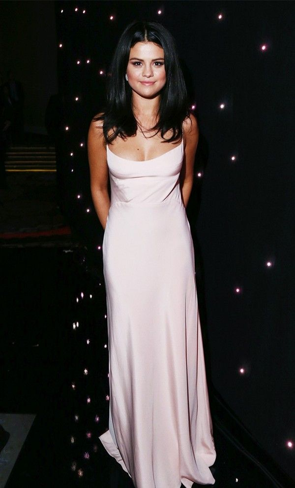 How stunning does Selena Gomez look in this light pink number?