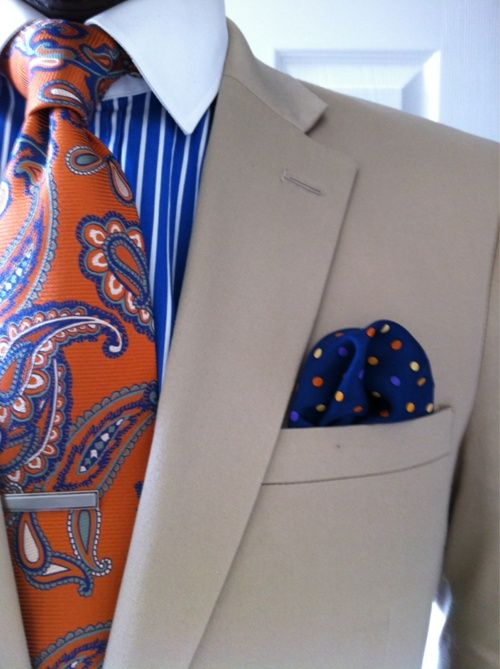 Men, make a statement by mixing stripes, paisley and polka dots.