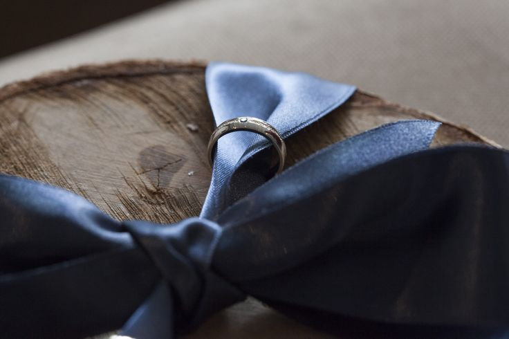 Different style of ring bearer. Wood and ribbon