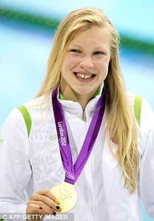 Lithuania's Ruta Meilutyte poses with her gold medal after winning in the 100m breastroke final - she lives in Plymouth in the West Country.