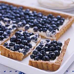 This low-calorie tart features a low-fat cookie crust, creamy lemon filling, and fresh blueberries. To turn it into a 4th of July dessert, top it with strawberries and blueberries.