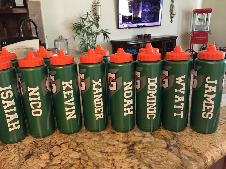 Personalized water bottles I made with my cricut explore for my sons little league baseball team.