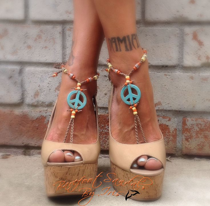 Crocheted light brown cotton cord that ties around your ankle. Peace sign pendants with beads.