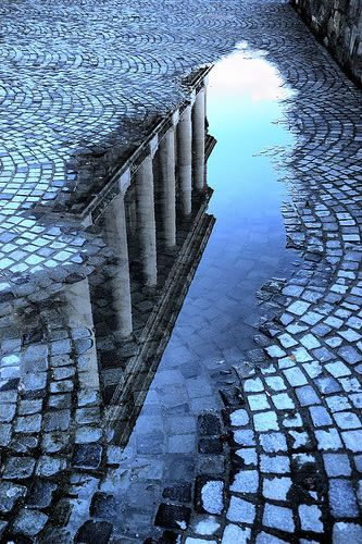 Reflection Photography  apply it to film by having someone step into the puddle and then blur the image
