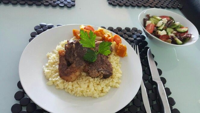 Cauliflower rice and lamb chop with side Greek salad.