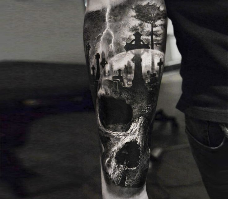 Photo – Skull and cemetery tattoo by Eliot Kohek