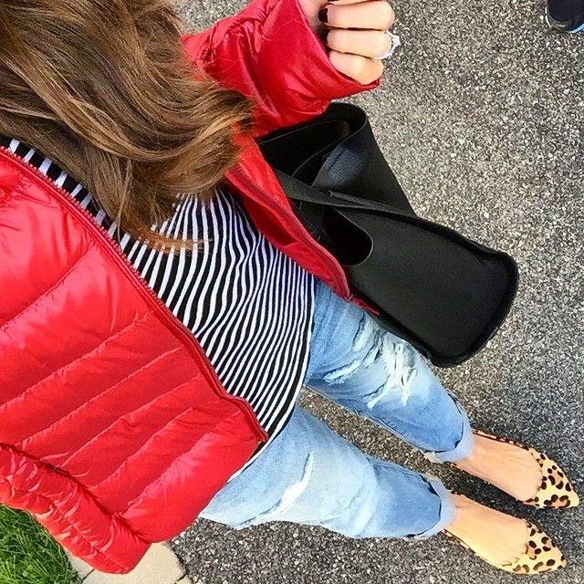 Uniqlo red puffer jacket.  Jcrew Striped tissue tee.  Gap Boyfriend Jeans.  Steve Madden leopard flats.  Forever 21 tote bag