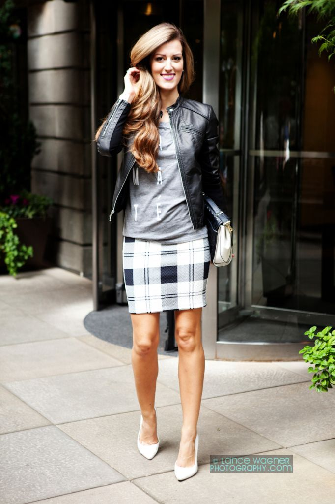 Pair a black leather bomber jacket with a grey plaid pencil skirt for a refined yet off-duty ensemble. White leather pumps will add elegance to an otherwise simple look.  Shop this look for $123:  http://lookastic.com/women/looks/pumps-pencil-skirt-clutch-long-sleeve-t-shirt-bomber-jacket/5753  — White Leather Pumps  — Grey Plaid Pencil Skirt  — Black and White Leather Clutch  — Grey Print Long Sleeve T-shirt  — Black Leather Bomber Jacket