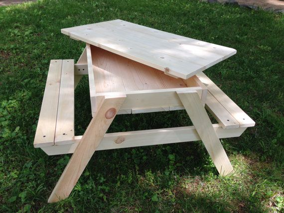 Kids picnic table with built-in sandbox and removable lid, 33W x 31L x 19H. Sturdy construction of solid pine, ready to paint or leave as is (natural finish). Great addition to the back yard, or put it in the playroom as a LEGO table!  We deliver FREE within Wake County, NC and Polk County, FL.